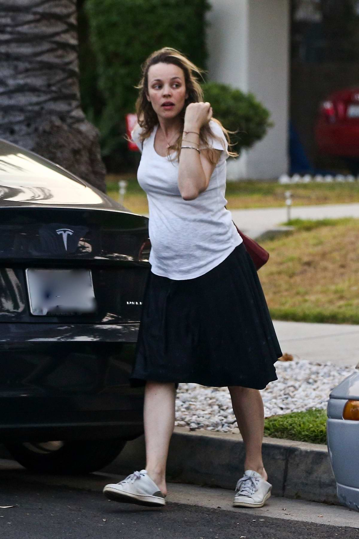Rachel McAdams shows her baby bump while visiting a friend in Los Angeles