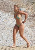 Rita Ora sports a jaguar print bikini while enjoying the beach with friends while on her summer holiday in Ibiza, Spain