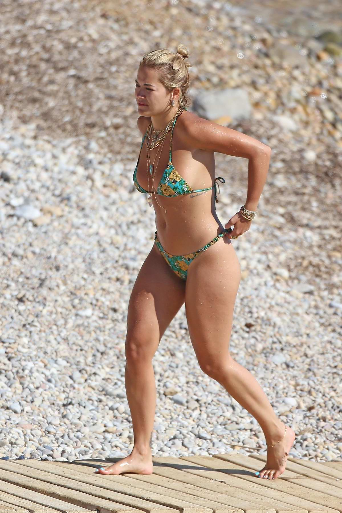 Rita Ora sports a jaguar print bikini while enjoying the beach with friends while on her summer holiday in Ibiza, Spain