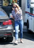 Robin Wright chats on the phone while out picking up some lunch to go at Pita Cafe in Los Angeles