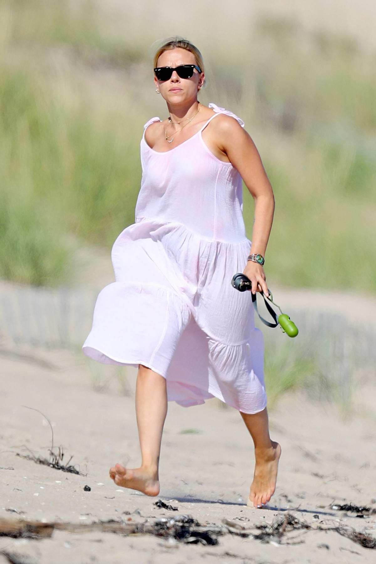 Scarlett Johansson seen wearing a pink sundress while enjoying the beach in The Hamptons, New York