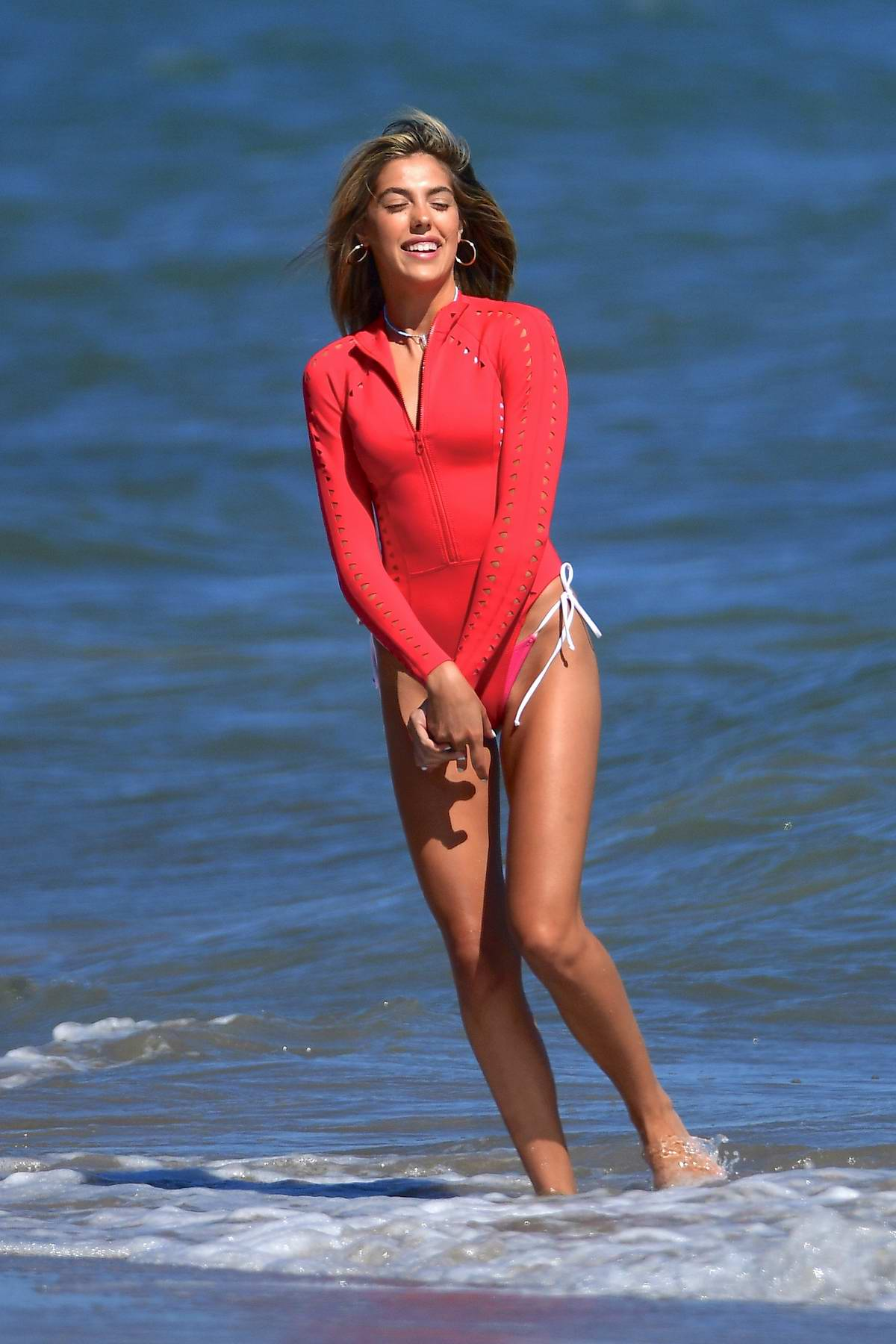 Sistine Stallone looks striking in a red swimsuit while enjoying a beach day with her dad Sylvester Stallone in Malibu, California