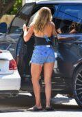 Sofia Richie flaunts her legs in denim shorts as she arrives at a friend's beach house in Malibu, California