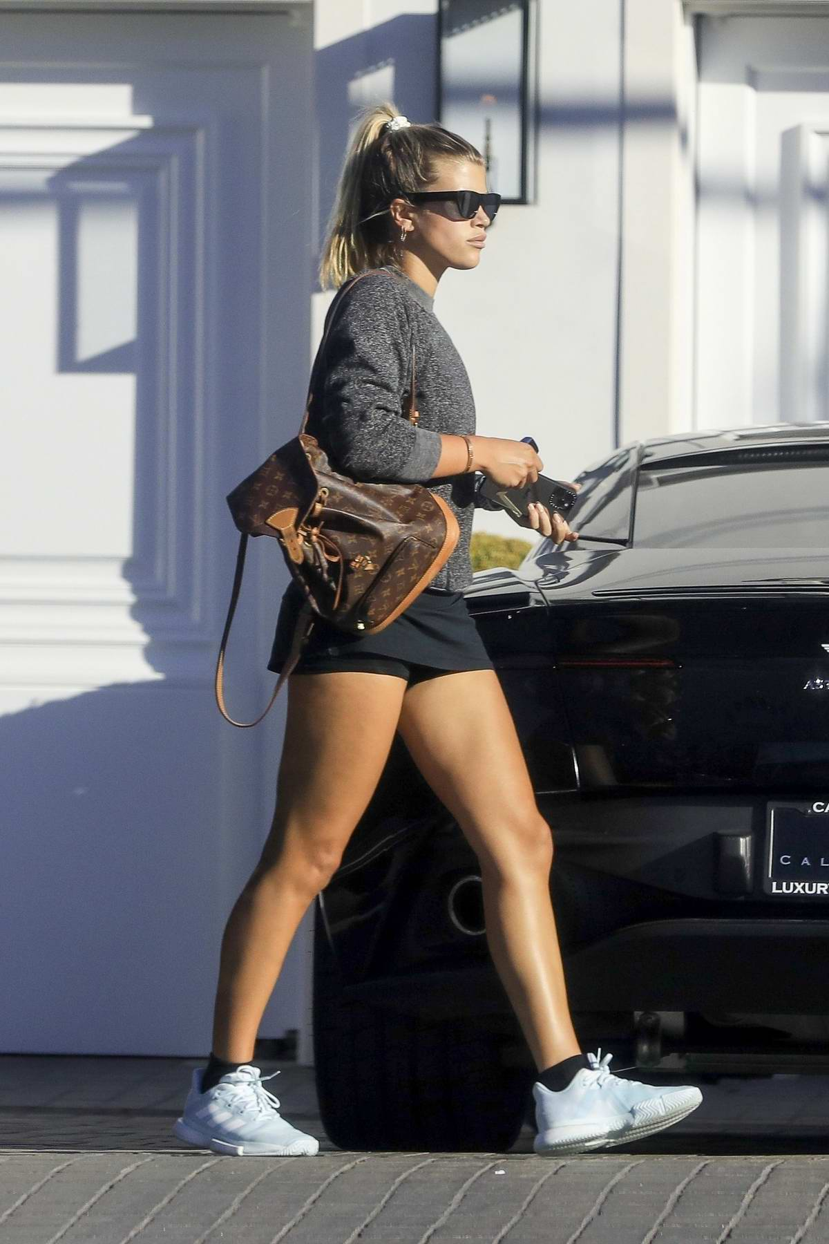 Sofia Richie shows some legs after a tennis session while stopping by a friend's house in Malibu, California