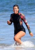 Sofia Richie slips into a wet suit as she hits the beach with friends for a fun day in Malibu, California