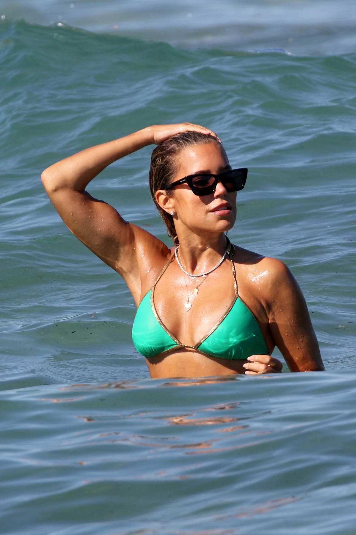 Sylvie Meis wears a green bikini as she enjoys another day at the beach with fiance Niclas Castello in Saint-Tropez, France