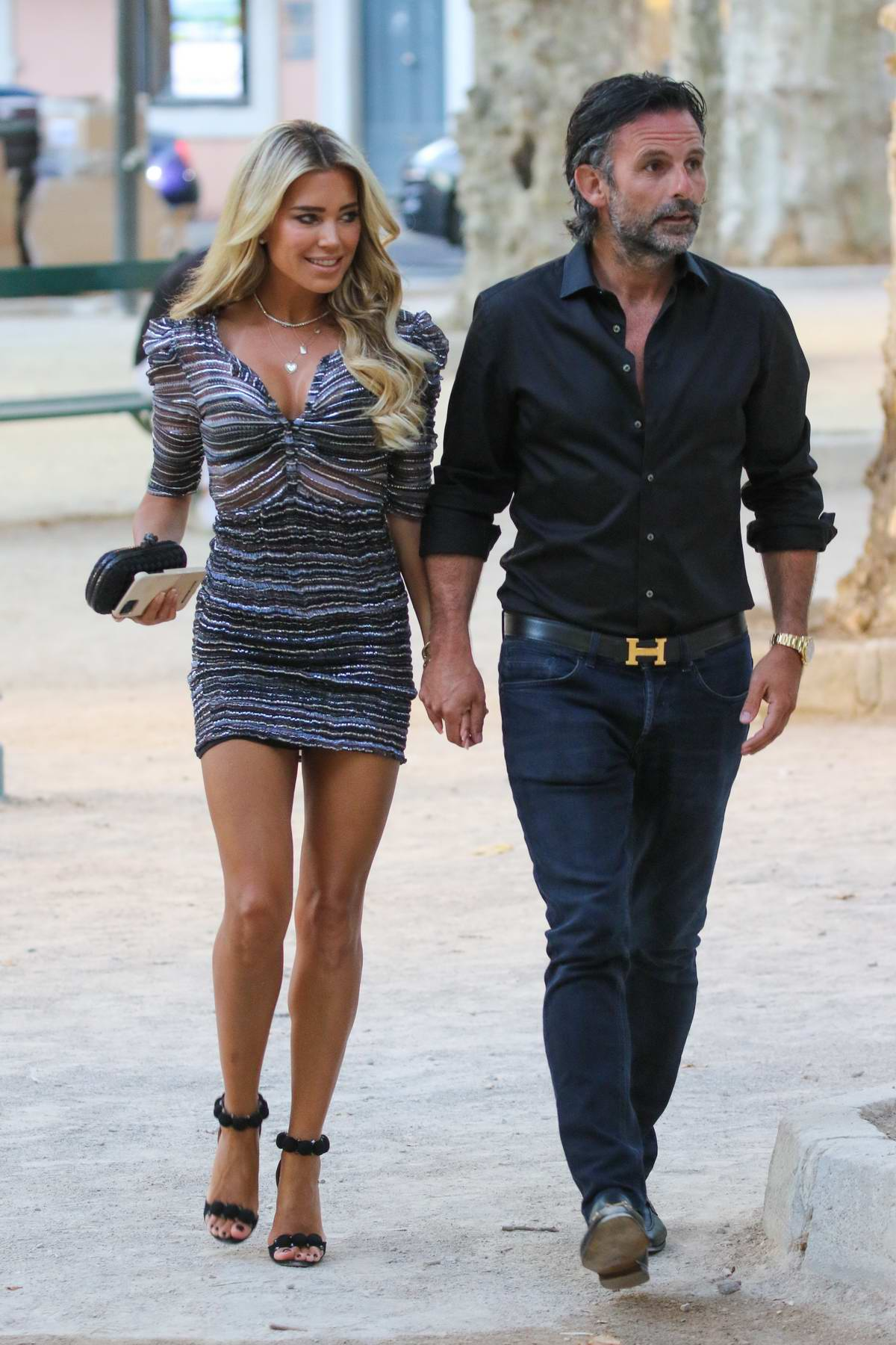 Sylvie Meis wears a striped mini dress while out with Niclas Castello in Saint-Tropez, France