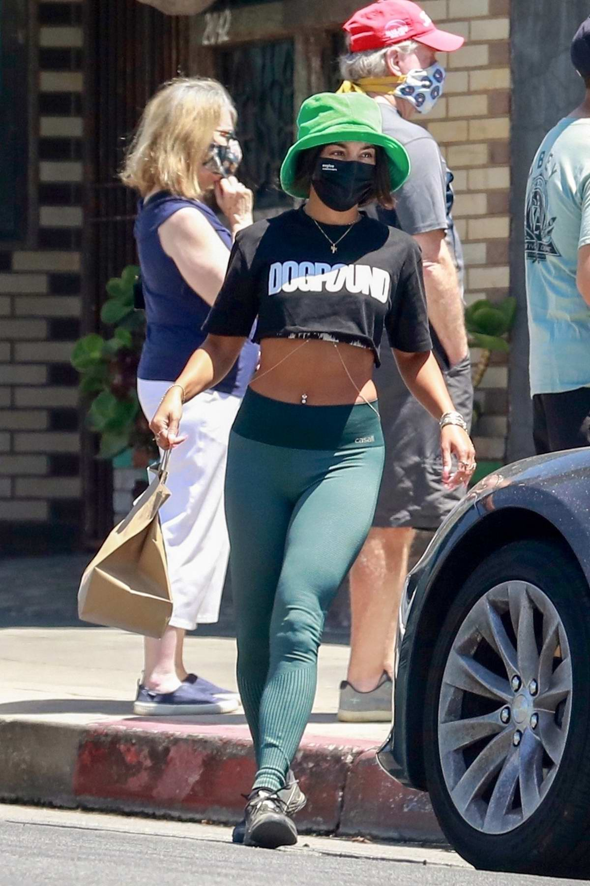 Vanessa Hudgens shows off her toned body in crop top and leggings while out to pick up lunch in Los Feliz, California