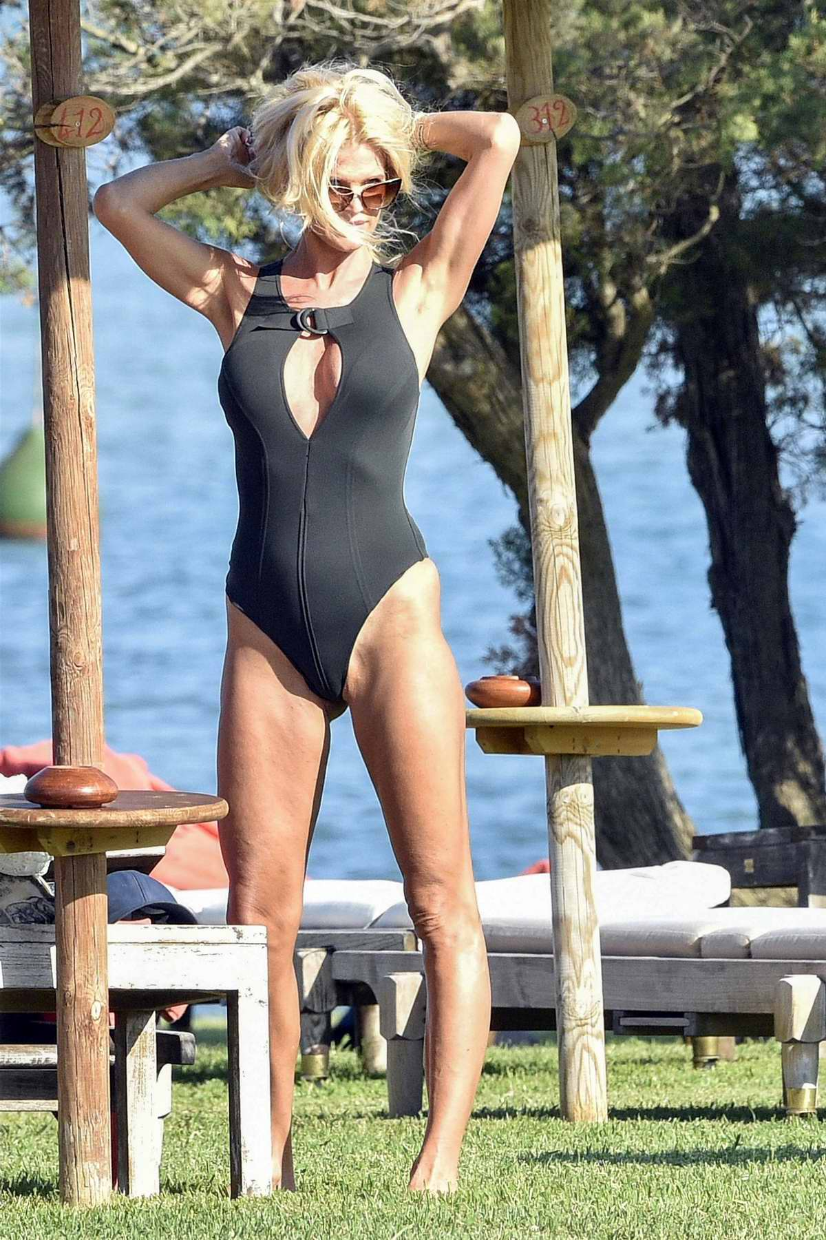 Victoria Silvstedt dons a black swimsuit while holidaying at the Luxury Hotel Cala di Volpe in Porto Cervo, Italy