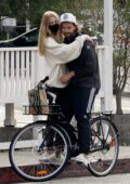 Abby Champion and Patrick Schwarzenegger pack on some PDA while making a coffee run at Starbucks in Los Angeles