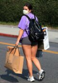 Addison Rae flaunts her toned legs in tiny shorts during a shopping trip with friends in Beverly Hills, California