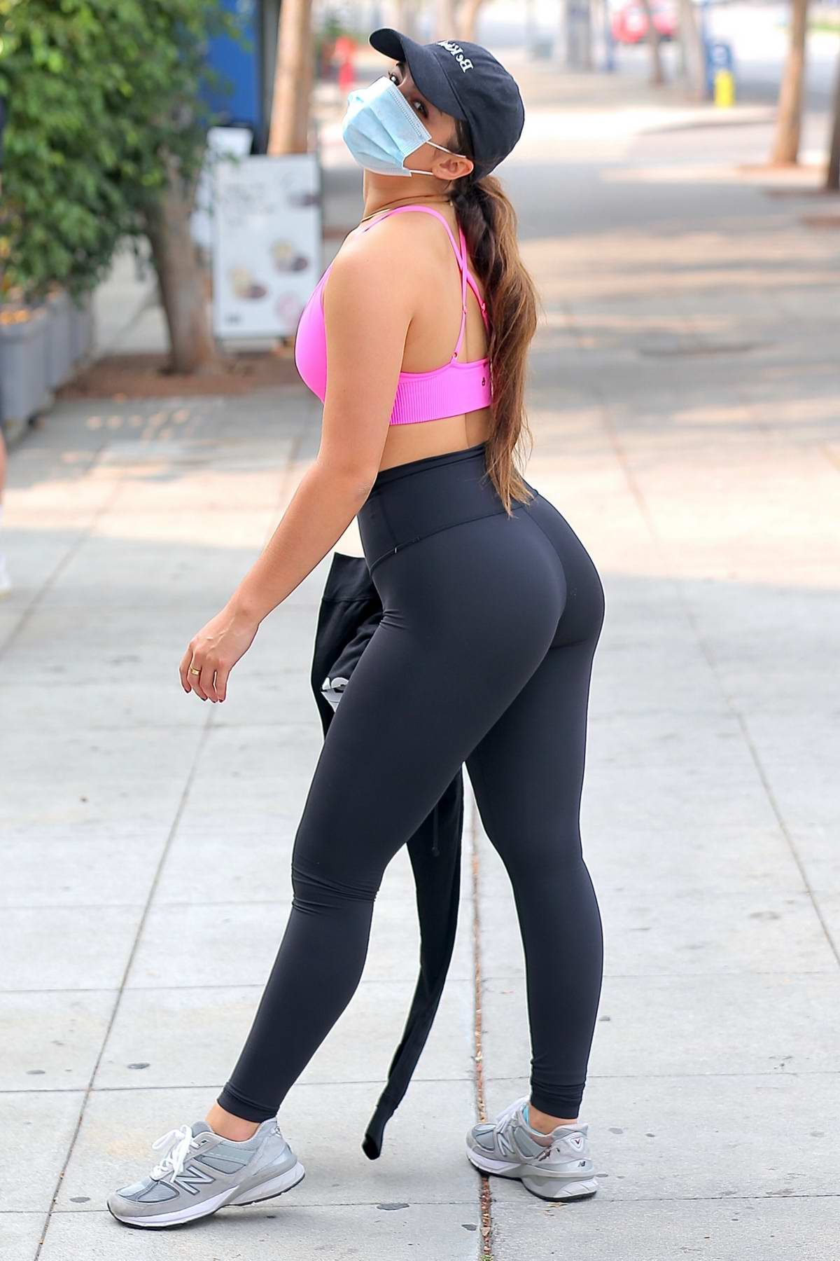 Addison Rae shows off her curves in a pink sports bra and black leggings while leaving workout in West Hollywood, California