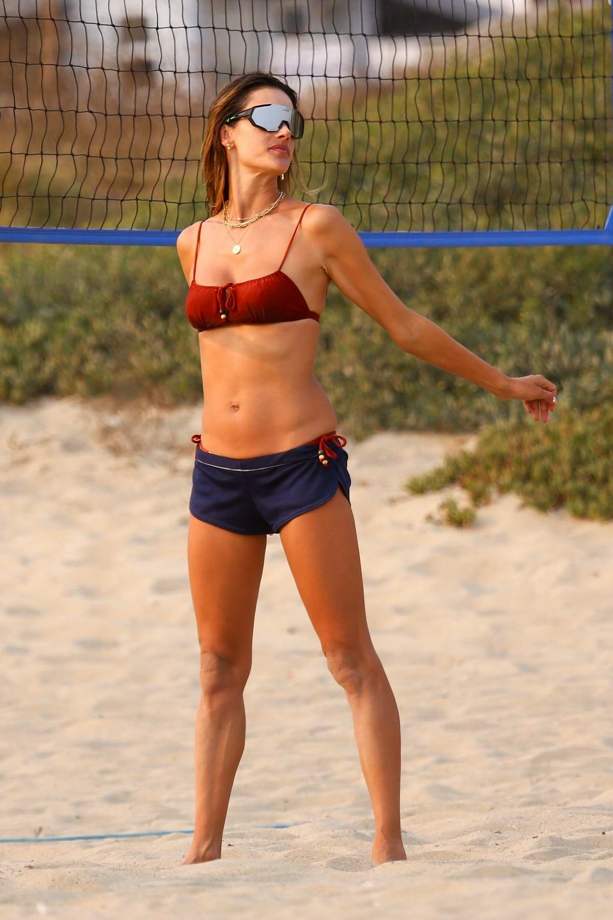 Alessandra Ambrosio flaunts her amazing physique during another day of beach volleyball with friends in Malibu, California