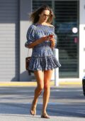 Alessandra Ambrosio shows off her long legs in a short dress as she stops by the bank in Brentwood, California