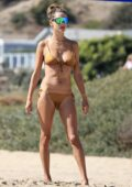 Alessandra Ambrosio stuns in a gold bikini as she enjoys the day on the beach in Los Angeles