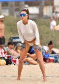 Alessandra Ambrosio stuns in a tie-dye bikini while playing volleyball on the beach with friends in Malibu, California