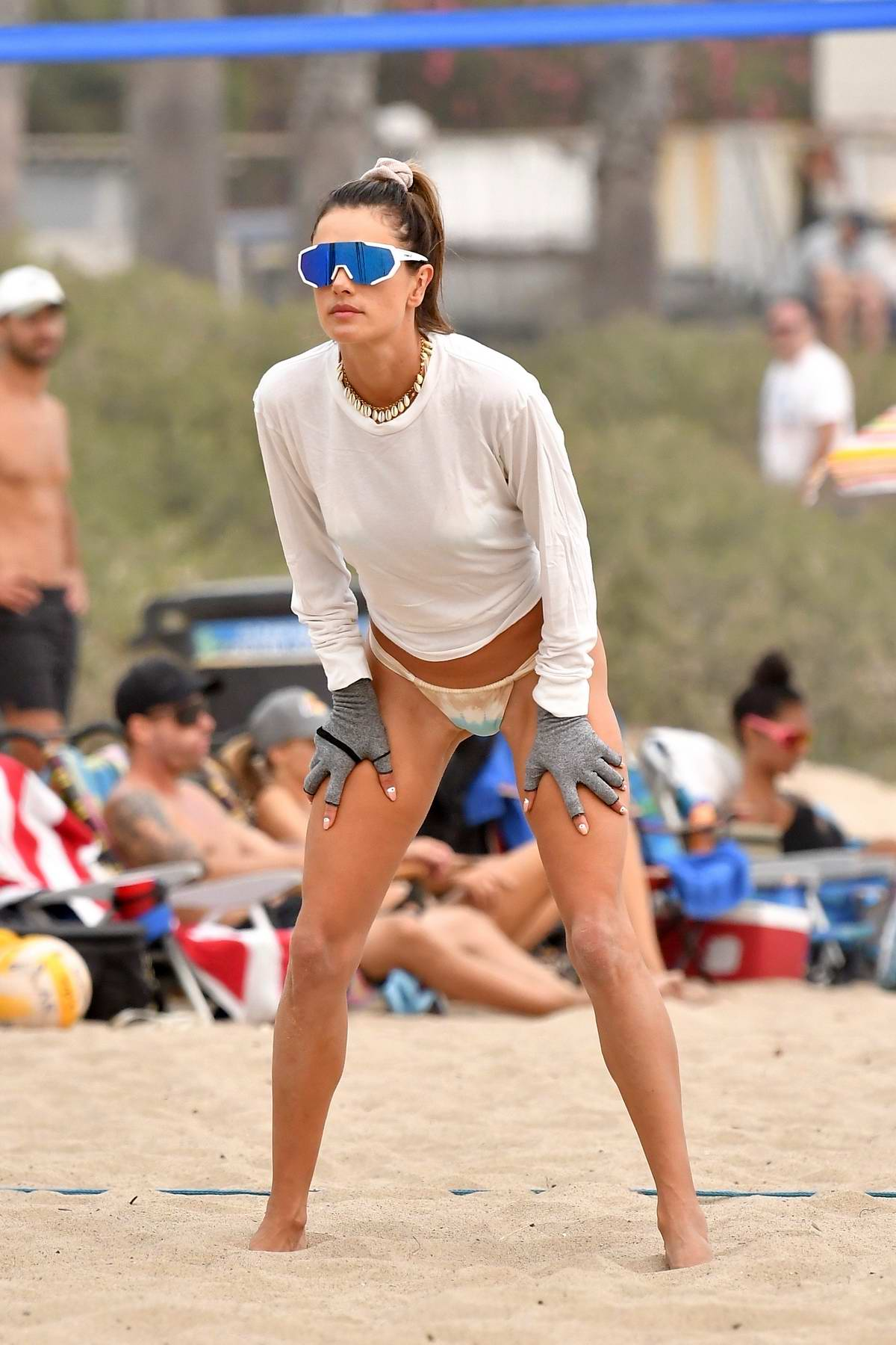 Alessandra Ambrosio stuns in a tie-dye bikini while playing volleyball on the beach with friends in Malibu, California