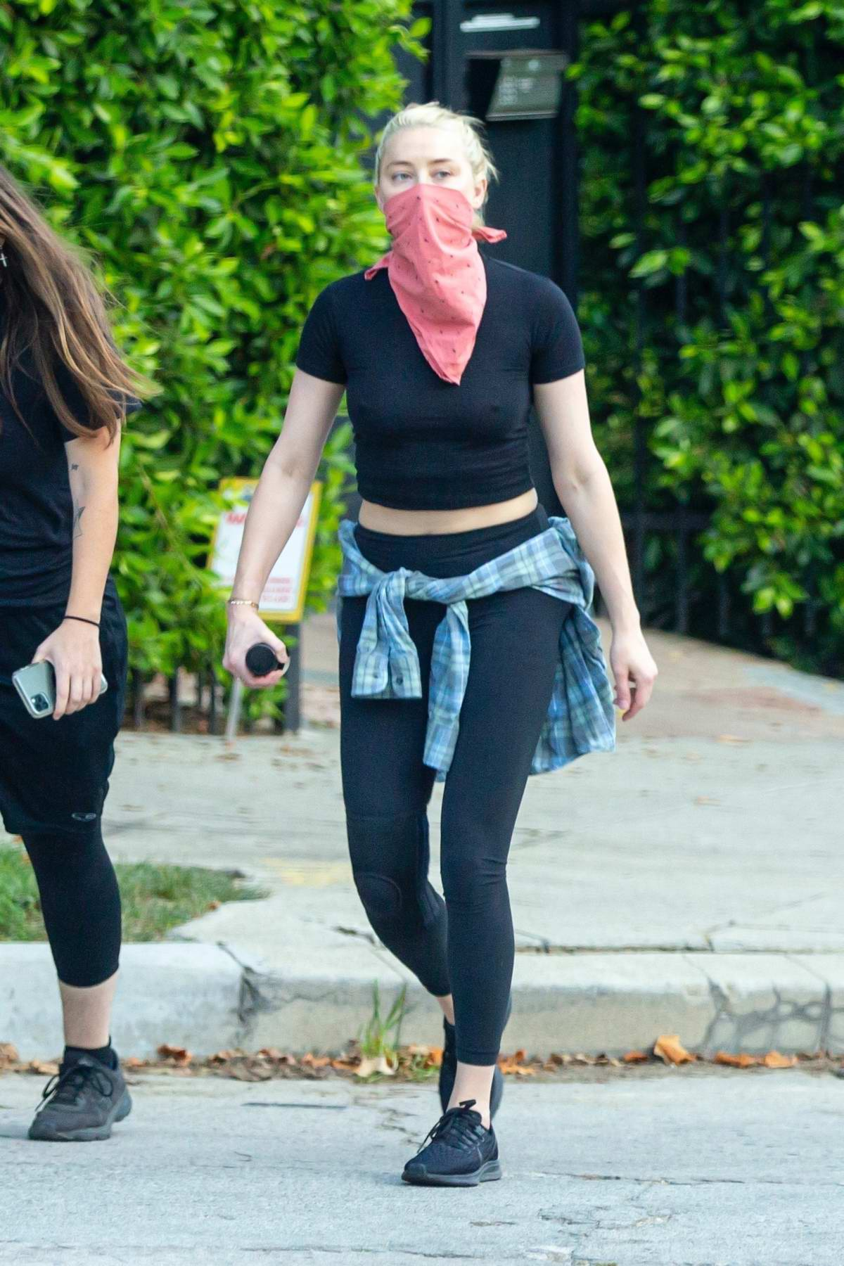 Amber Heard sports a black crop top and leggings during an afternoon hike with a friend at Griffith Park in Los Angeles