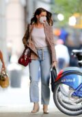 Anne Hathaway looks stylish in a plaid blazer with jeans as she leaves a hair salon in New York City
