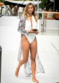 Arabella Chi showcases her incredible figure in a white swimsuit during a photoshoot in Ibiza, Spain