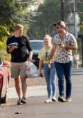 Ariel Winter and boyfriend Luke Benward greet a family member outside their home in Studio City, California