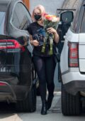 Ariel Winter carries a flower bouquet while running errands in Studio City, California