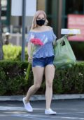 Ariel Winter puts on a leggy display while picking up a cake and some flowers in Los Angeles
