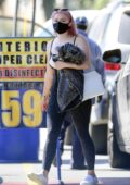 Ariel Winter rocks a black top and leggings while making a stop at the car wash in Los Angeles