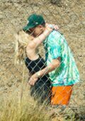 Ashley Benson gets a hug and kiss from boyfriend G-Eazy as she arrives at his video shoot in Malibu, California