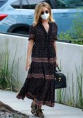 Ashley Tisdale hides her baby bump under her maxi dress while leaving a friend's house in West Hollywood, California