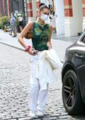 Bella Hadid looks trendy as she heads out of her apartment with a mystery guy in New York City