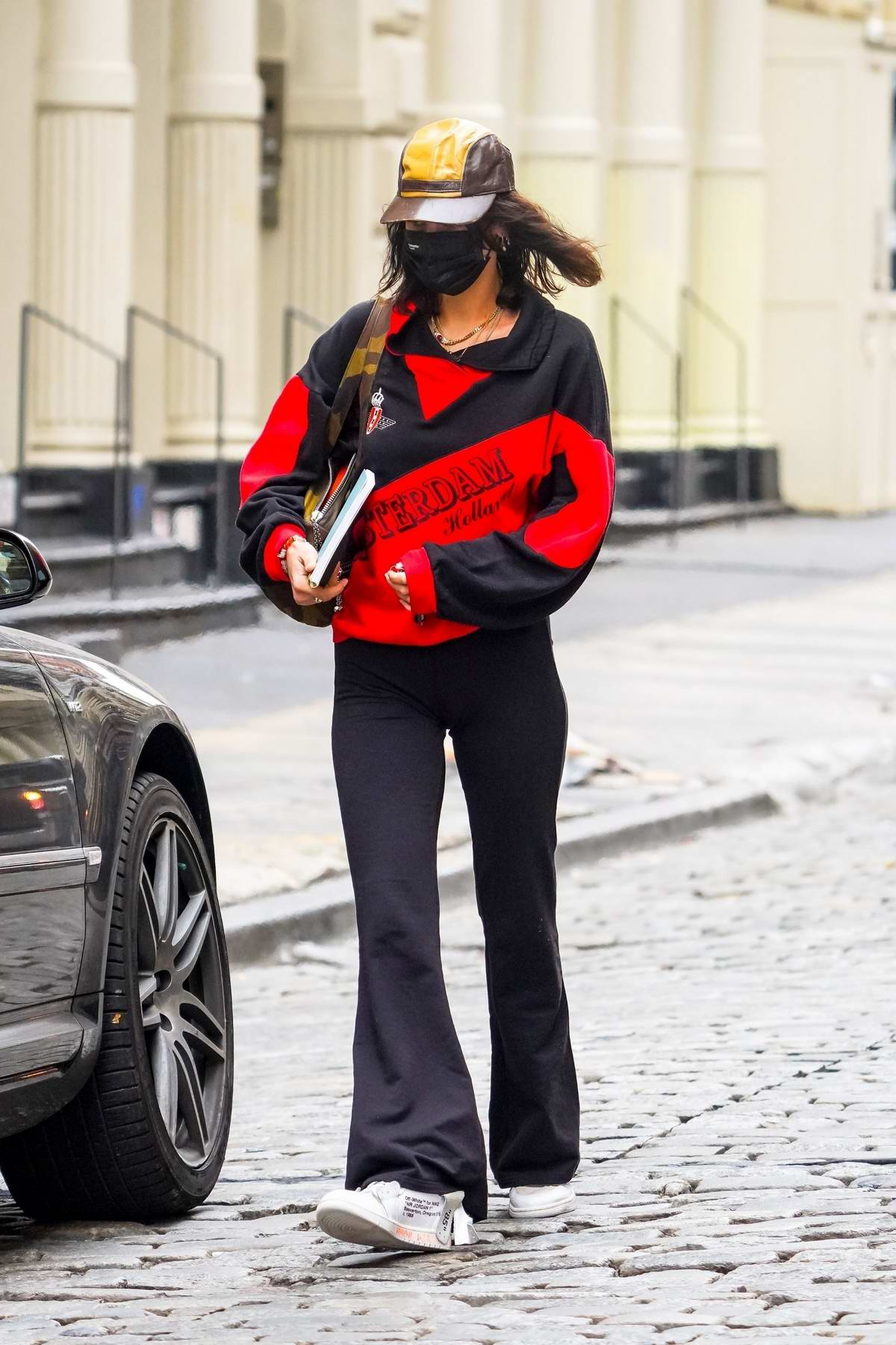 Bella Hadid sports black and red while heading to a studio in Brooklyn, New York
