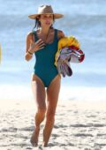 Bethenny Frankel wears a teal swimsuit while enjoying a beach day in The Hamptons, New York