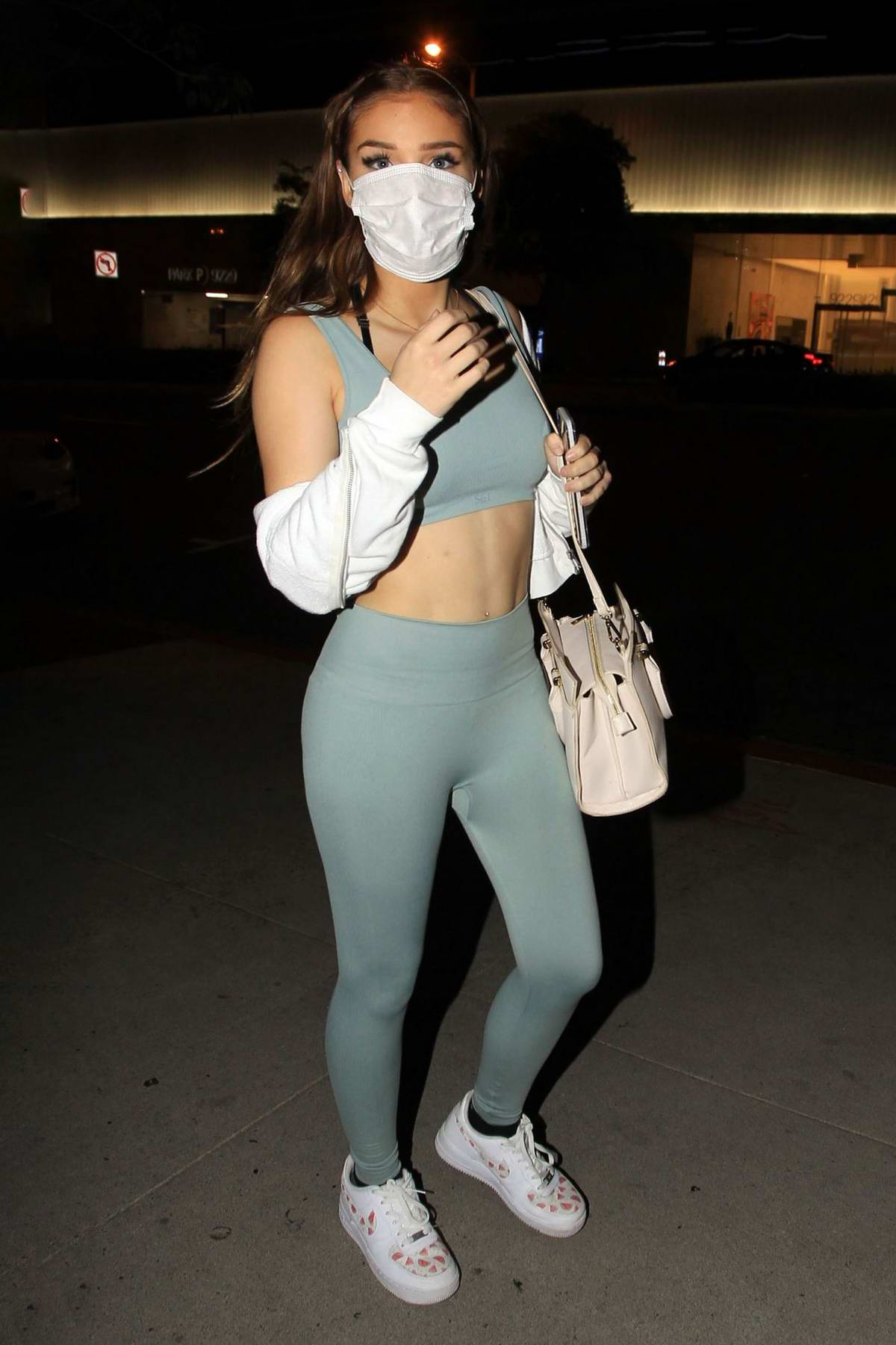 Brighton Sharbino shows off her toned abs in matching workout top and leggings during a night out in Los Angeles