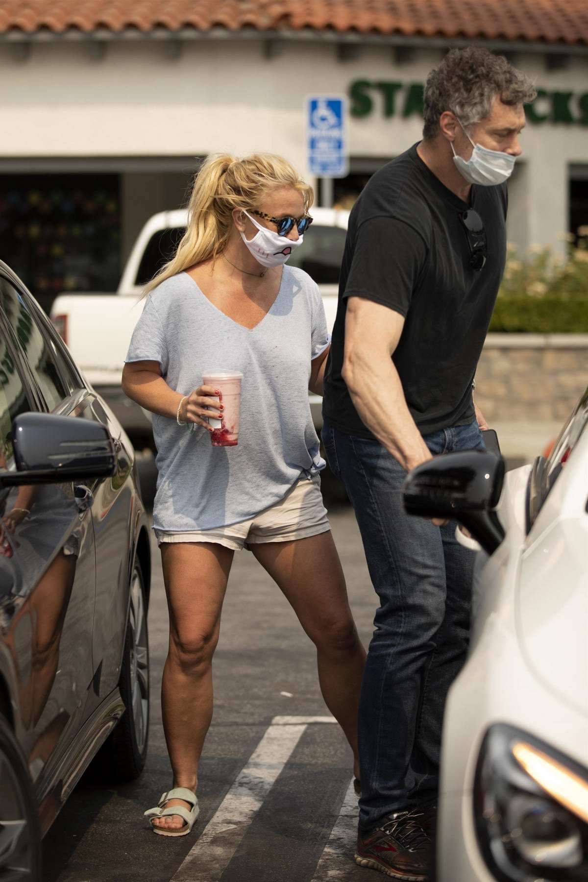 Britney Spears keeps it casual in a grey top and shorts while making a stop at a Starbucks in Calabasas, California