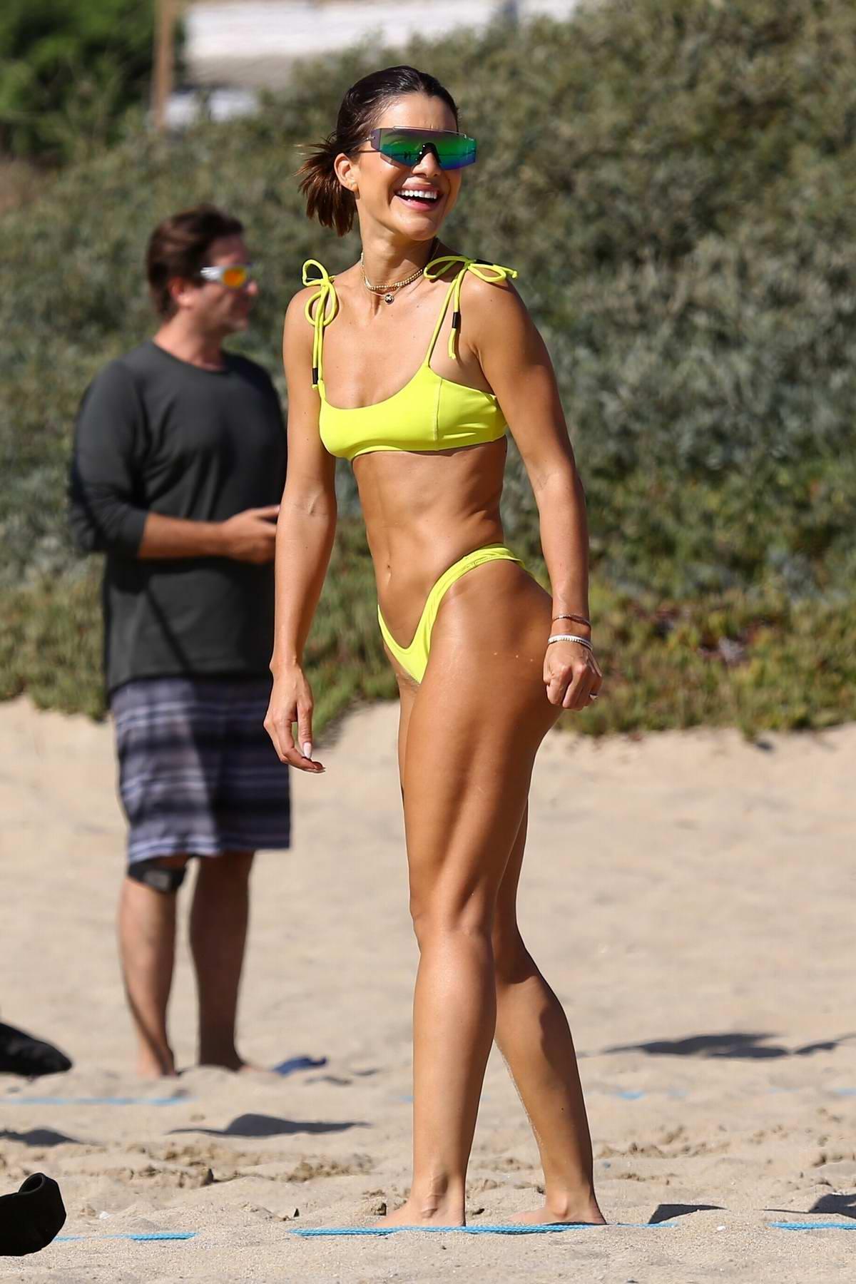 Camila Coelho stuns in yellow bikini while enjoying a beach day with Alessandra Ambrosio in Santa Monica, California