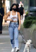 Camila Mendes sports a cropped tank top and jeans while taking her dog Truffle for a walk in Vancouver, Canada