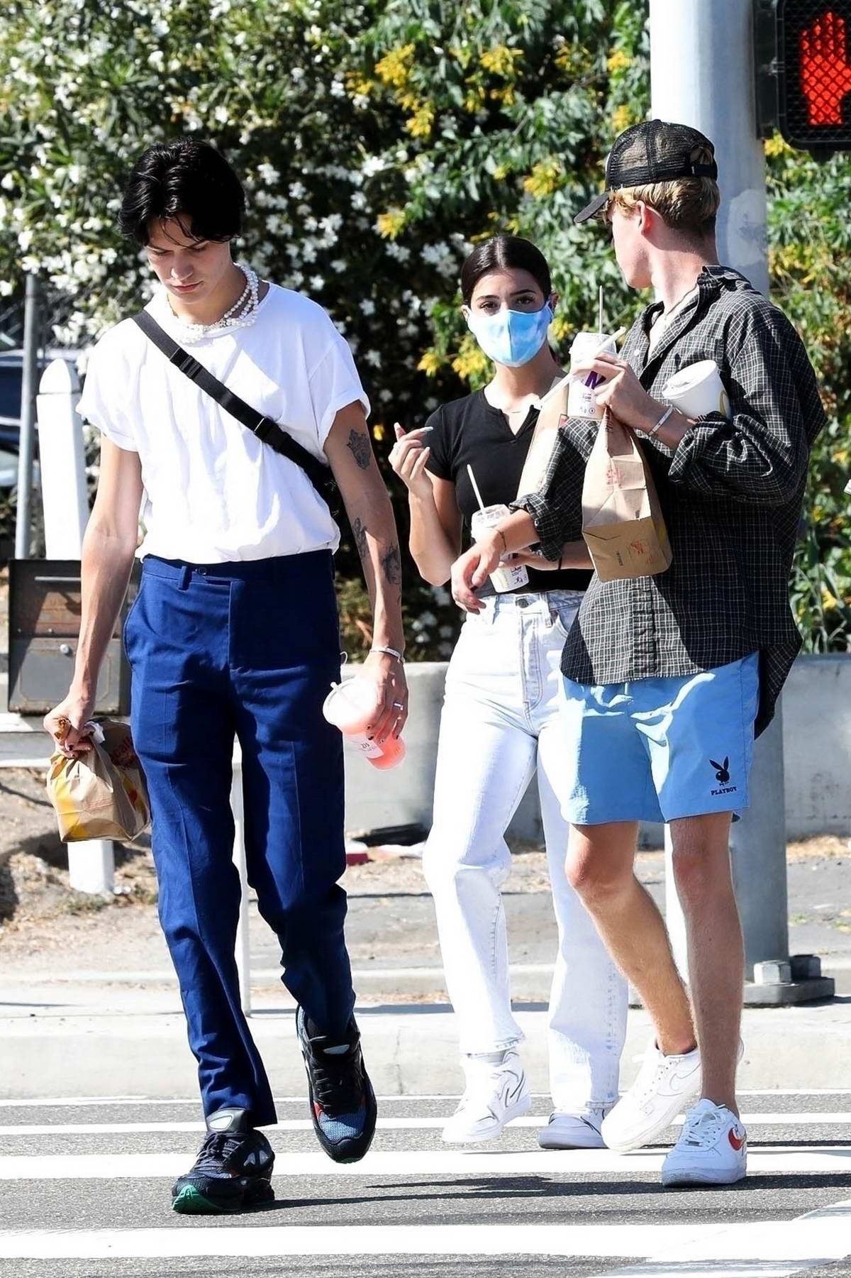 Charli D'Amelio, boyfriend Chase Hudson and Nick Austin hit up the McDonald's with friends in Malibu, California