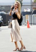 Chrishell Stause waves for the camera as she leaves the DWTS studio in Los Angeles
