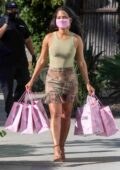 Christina Milian has her hands full with PLT merchandise while leaving PLT Headquarters in West Hollywood, California