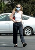 Dakota Fanning bares her midriff in a cropped tank top while out shopping groceries at Vons in Burbank, California
