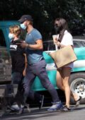 Dakota Johnson dons a white romper during a lunch outing with Chris Martin in the Hamptons, New York