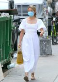 Diana Agron looks radiant in a white dress while out for a stroll in Soho, New York