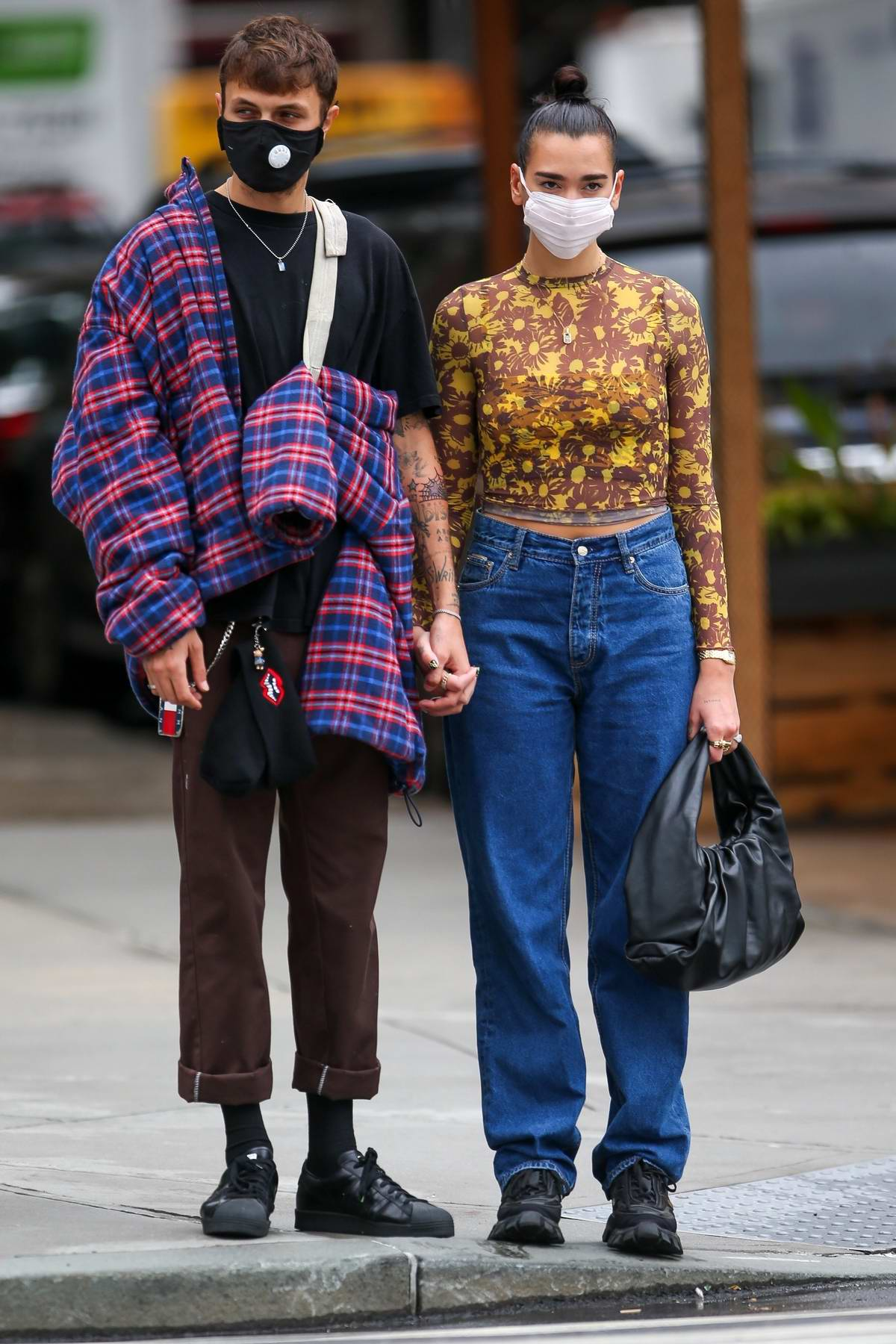 Dua Lipa wears a colorful crop top and denim while out on a stroll with Anwar Hadid in New York City