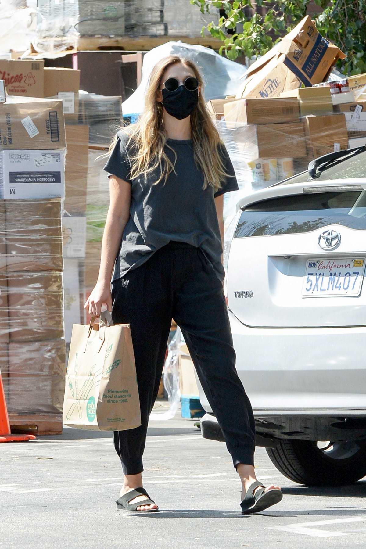 Elizabeth Olsen keeps it casual for a grocery run with fiance Robbie Arnett in Sherman Oaks, Calfornia