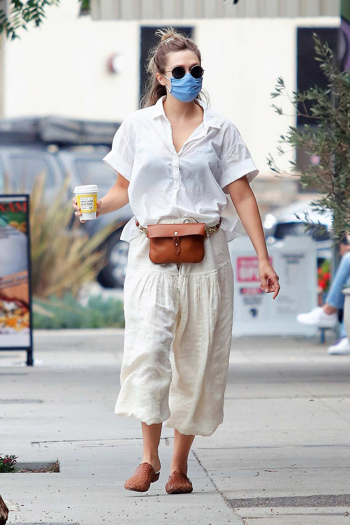 Elizabeth Olsen wears an all-white ensemble while making a coffee run to Alfred's in Los Angeles