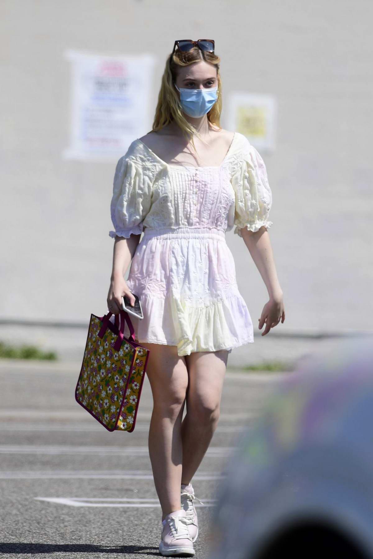Elle Fanning looks pretty in a cute tie-dye dress during a shopping trip in Los Angeles