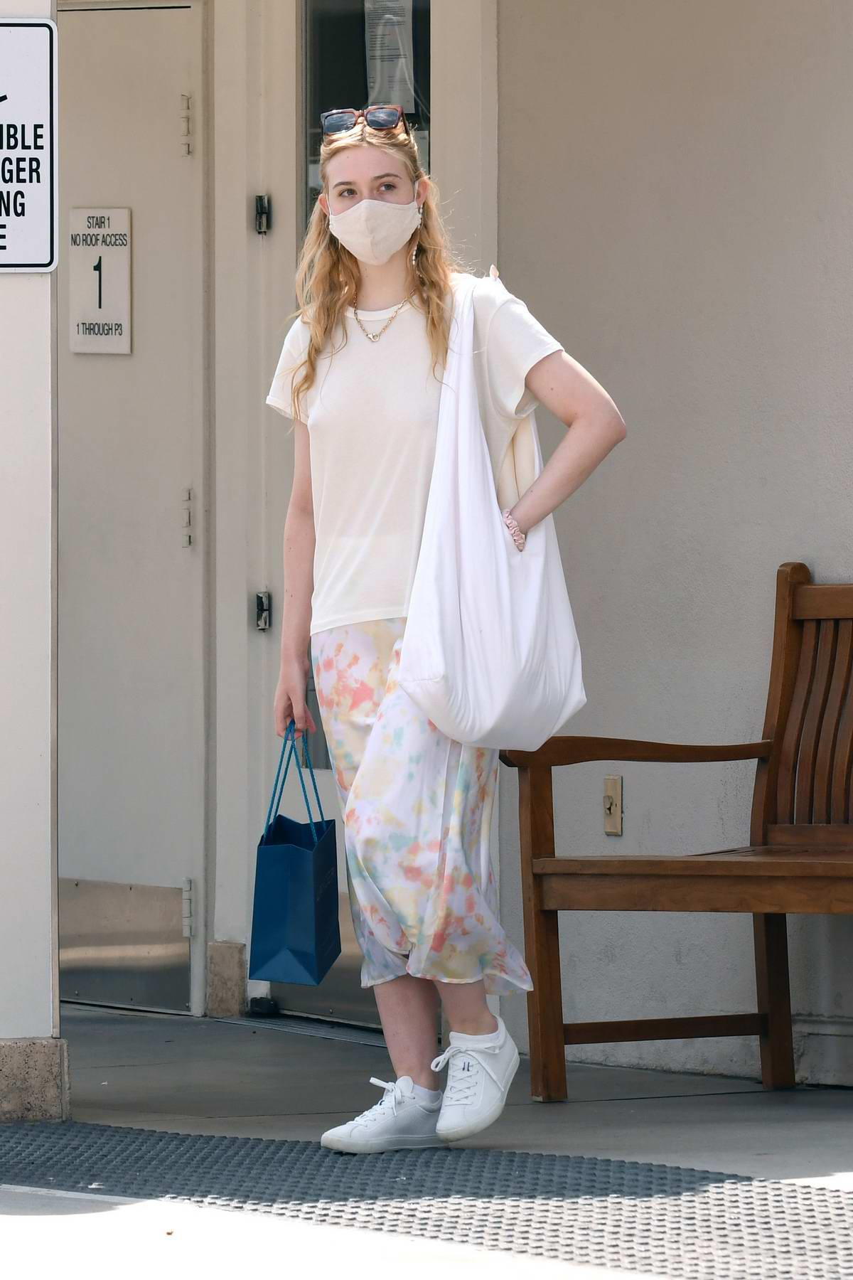 Elle Fanning wears an off-white top and tie-dye skirt while out for some shopping with her mom in Los Angeles