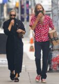 Elsa Hosk cuts a stylish figure in black trench coat while out with beau Tom Daly in New York City