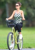 Emily Ratajkowski looks cute in polka dot top while riding her bike to the beach in the Hamptons, New York